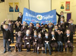 School children with a Mission Together banner