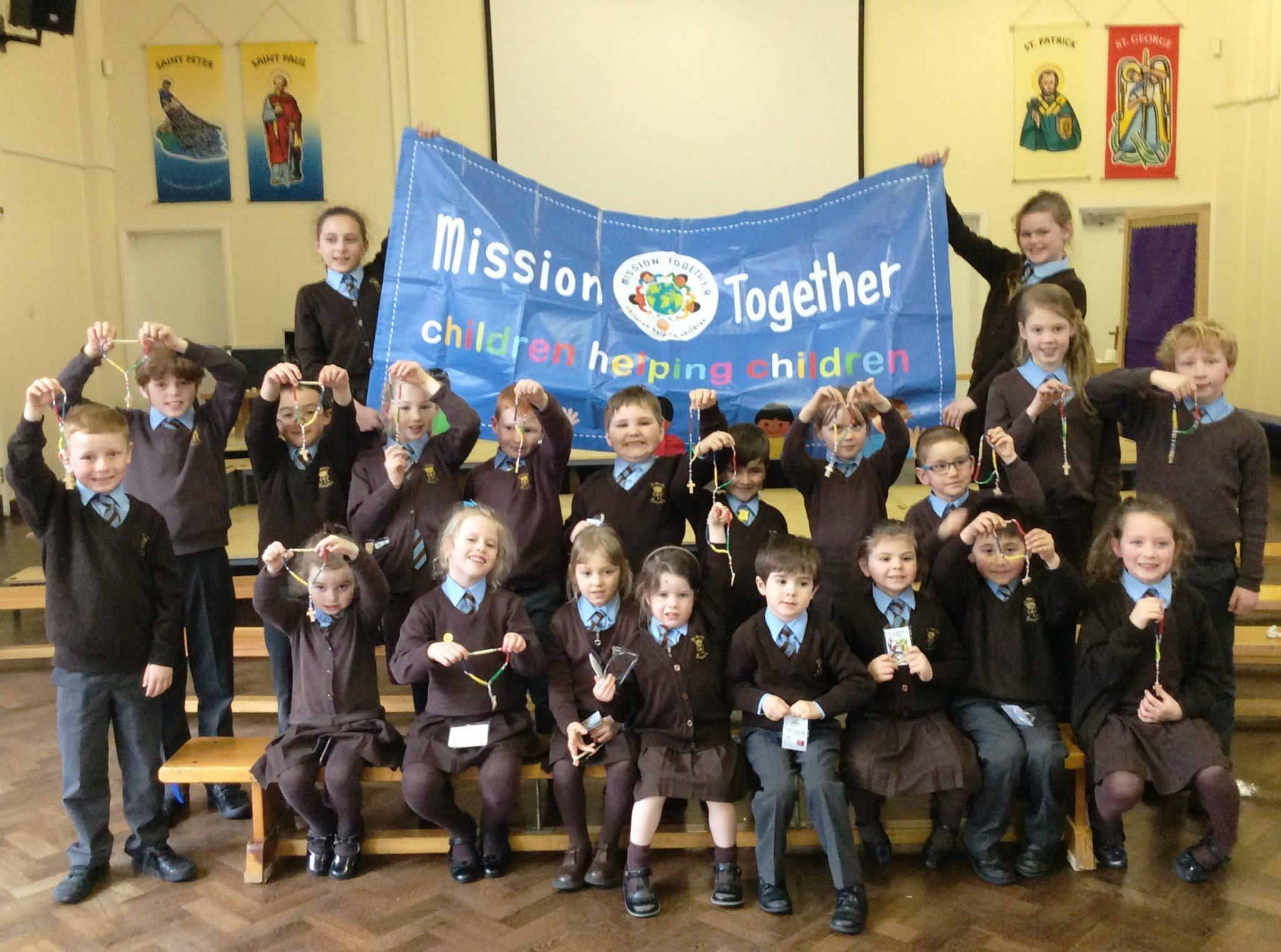 Children from St Mary's, Chingford with a Mission Together banner