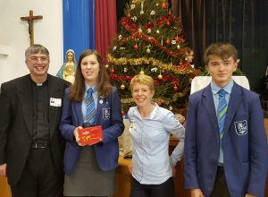 St Thomas More students, Diocesan Director, Father Anthony Grace, Red Box