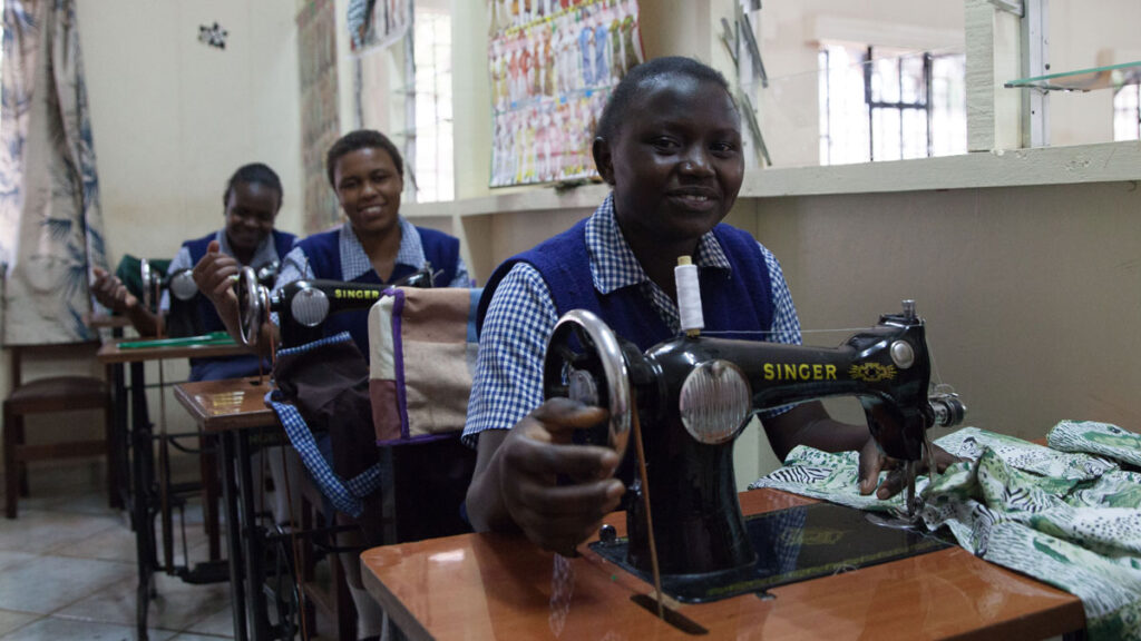 Young women working on sewing machines