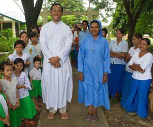 Fr John Paul with members of his parish