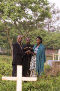 Prayers at dawn in a graveyard