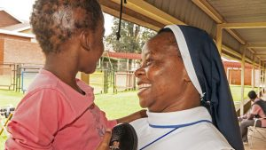 Sr Carolyne and a little girl
