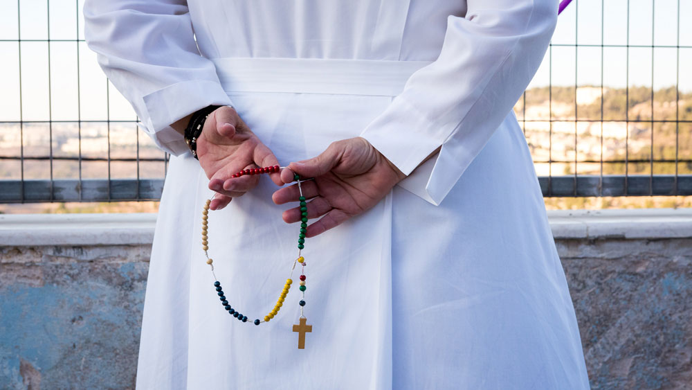 A nun holds a rosary in the Holy Land