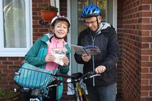 Trish and her husband setting out to deliver Missio material to Red Box holders